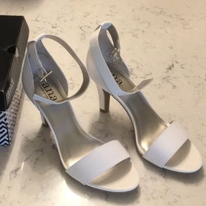 Like New, worm once, white sandal heels, size 6
